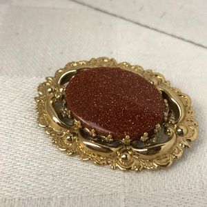 Vintage gold stone brooch
